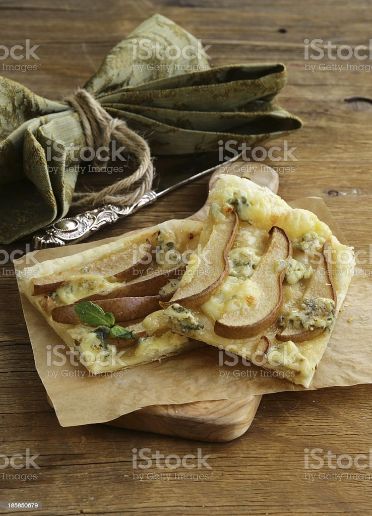 Puff pastry tart with blue cheese and pears royalty-free stock photo