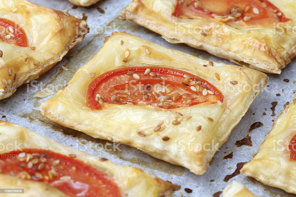 Puff pastry with cheese and tomatoes royalty-free stock photo