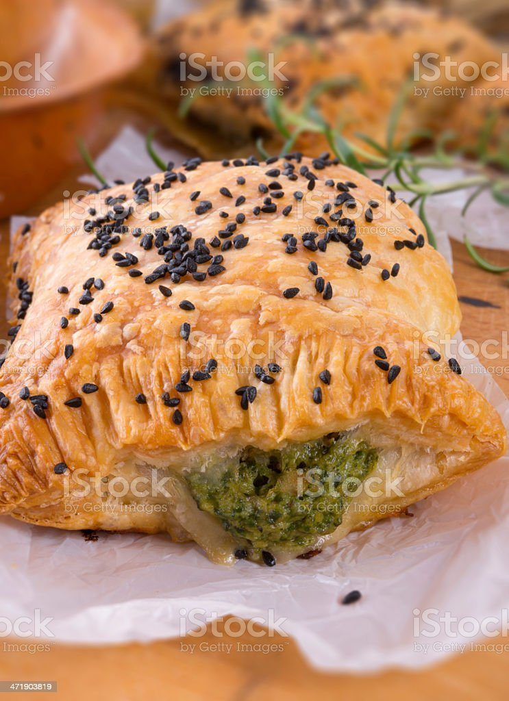 puff pastry with spinach filling and black cumin royalty-free stock photo