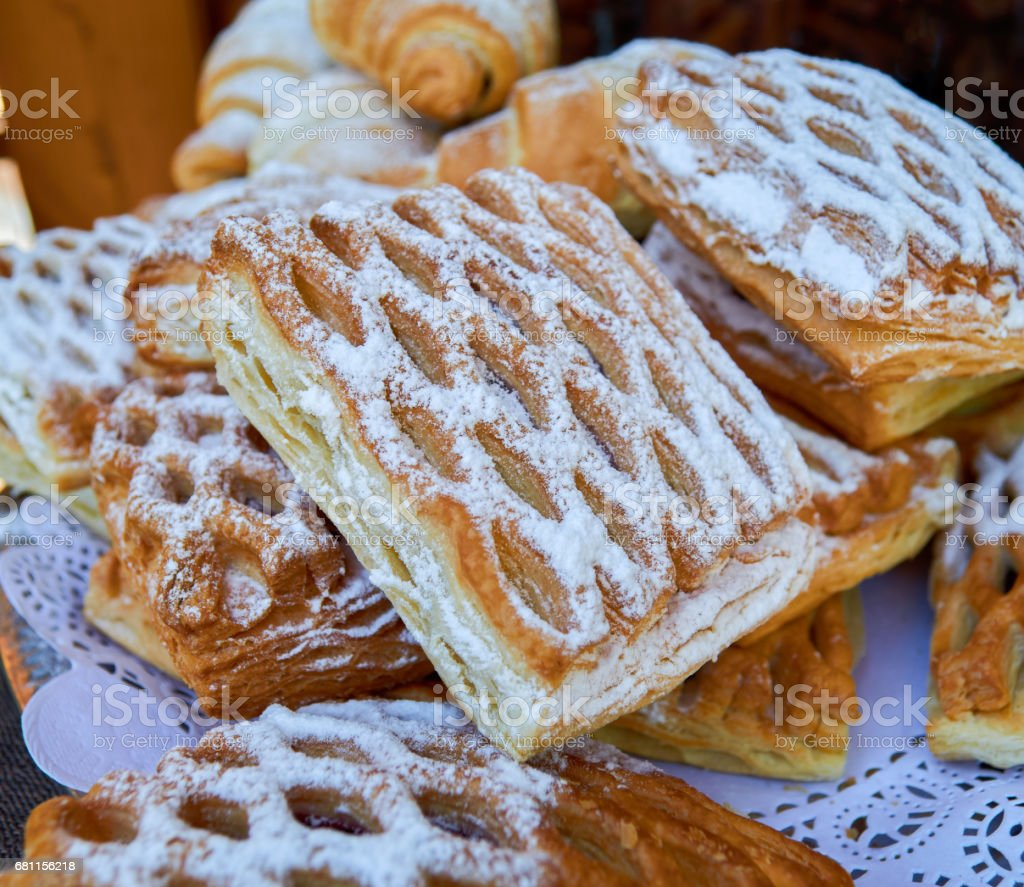 Puff pastry with stuffing and croissants stock photo