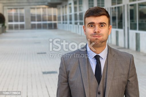 Puffed businessman feeling bloated with copy space.