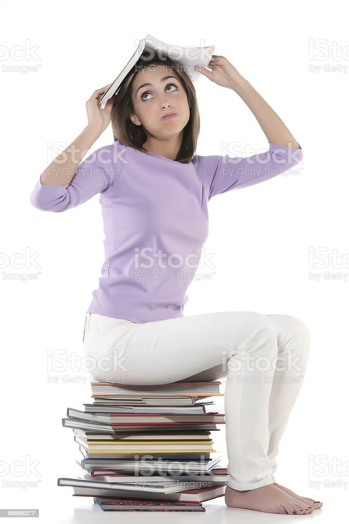 Puffing woman sitting on stack of books royalty-free stock photo