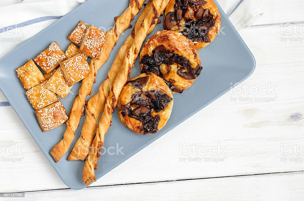 Puffs with caramelized onions and mushrooms stock photo