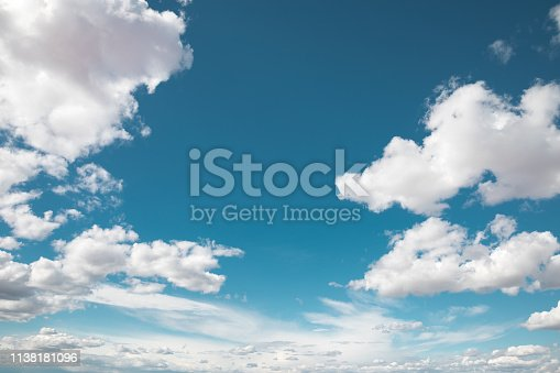 Blue summer sky with fluffy white clouds.