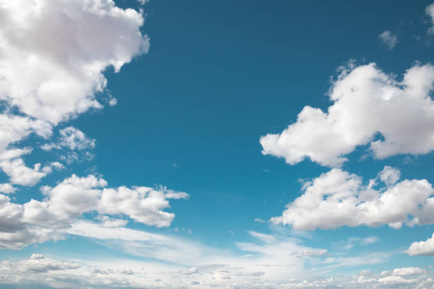 Puffy Clouds Blue summer sky with fluffy white clouds. cloud sky stock pictures, royalty-free photos & images
