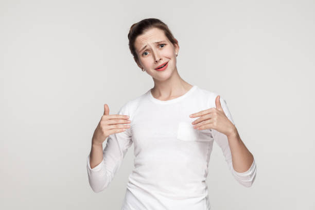 Puffy funny woman pointing hands himself and looking at camera. stock photo
