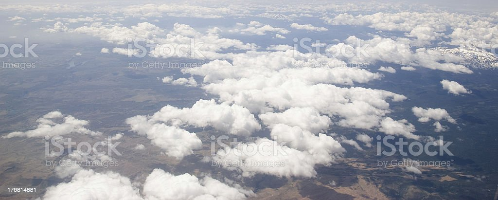 Puffy White Clouds on Blue Sky Background royalty-free stock photo