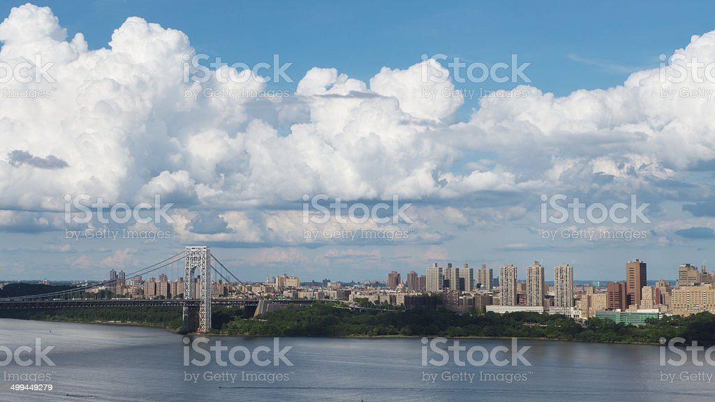 Puffy White Clouds over Manhattan stock photo