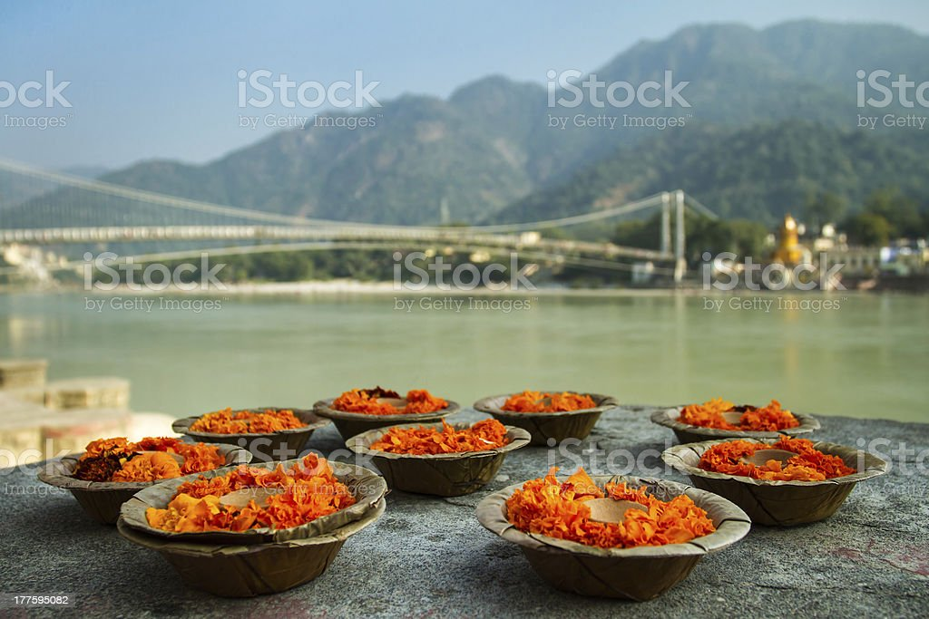 Puja flowers offering at the bank of Ganges river stock photo