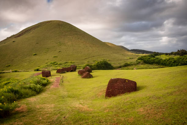 Pukaos quarry in Easter Island, the hats of the moais. Landscape and detail of the red hats of the moais in the quarry stock photo