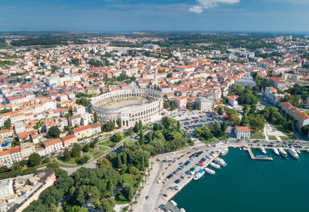 Pula Arena Amphitheatre, Croatia Aerial of the famous Pula Arena Amphitheatre, Croatia. Converted from RAW. amphitheater stock pictures, royalty-free photos & images