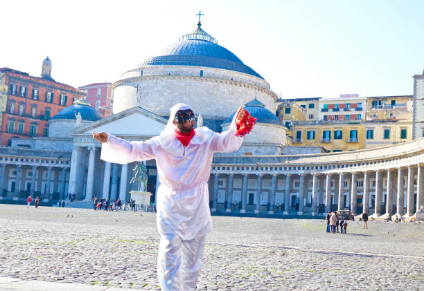 Pulcinella in Piazza del Plebiscito, Napoli Napoli, Italy - December 23th, 2016: A man dressed as Pulcinella dances in Piazza del Plebiscito auk stock pictures, royalty-free photos & images