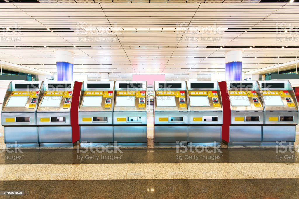 pull ticket from automatic machine at shanghai-train station stock photo