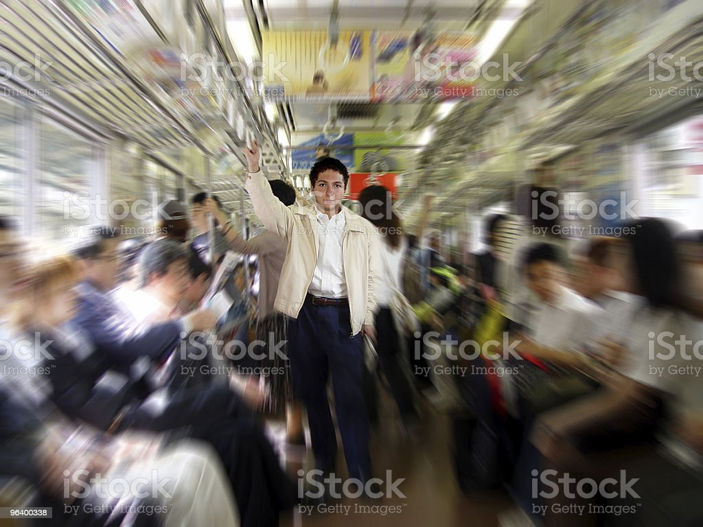 Pulled focus image of a man standing on a train royalty-free stock photo
