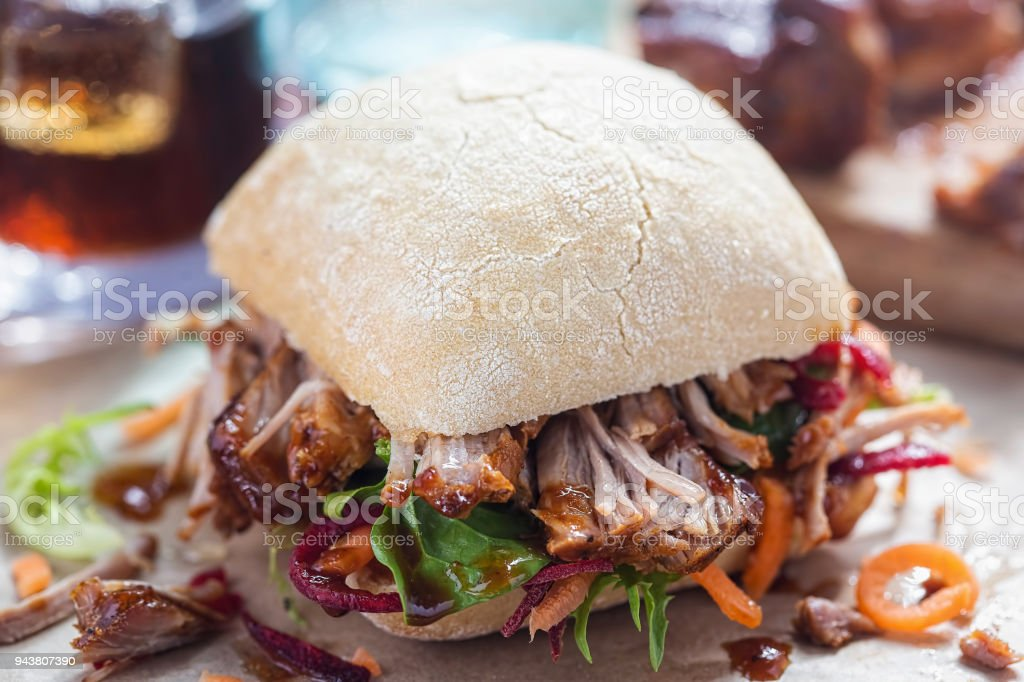 Pulled pork ciabatta with mixed lettuce leaves stock photo