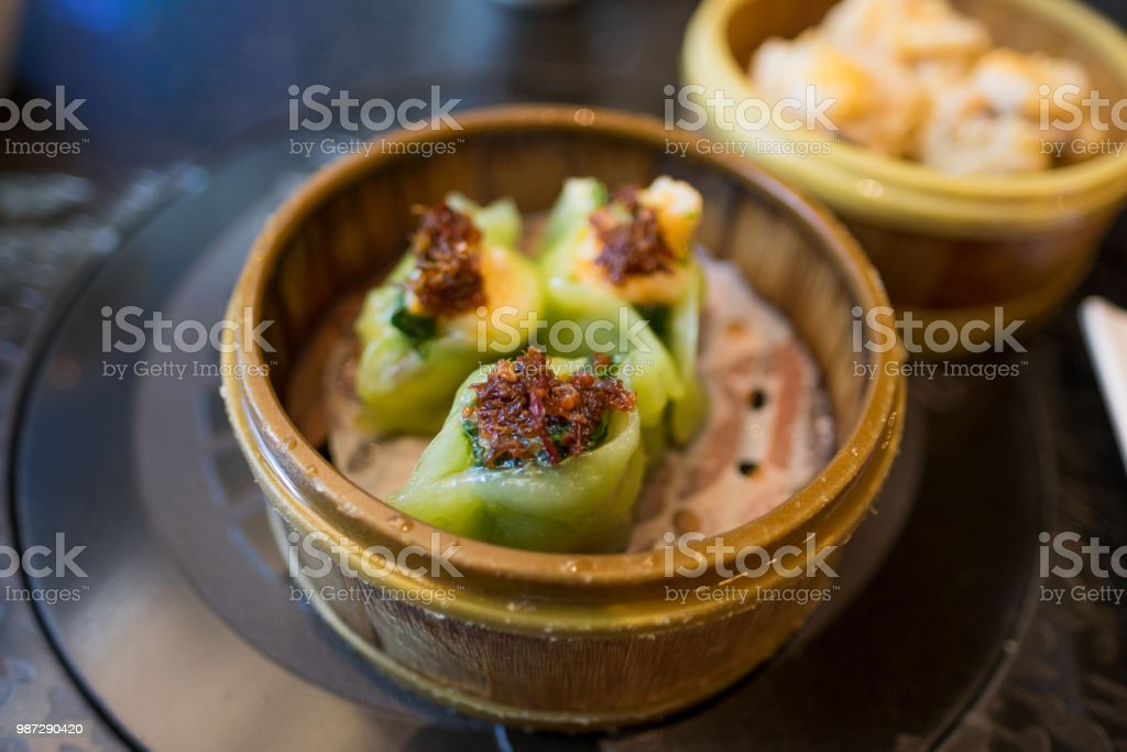 Pulled pork - dumpling - green casing stock photo
