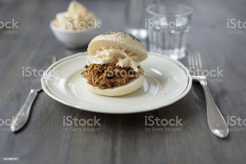 Pulled pork in a bun stock photo