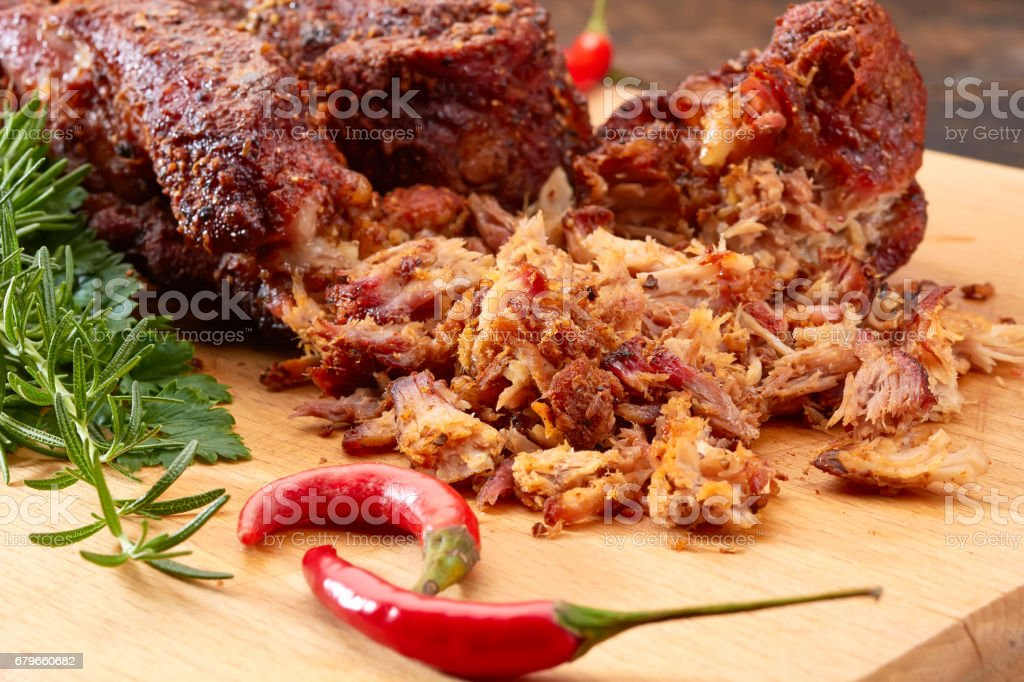 Pulled pork on wooden board stock photo