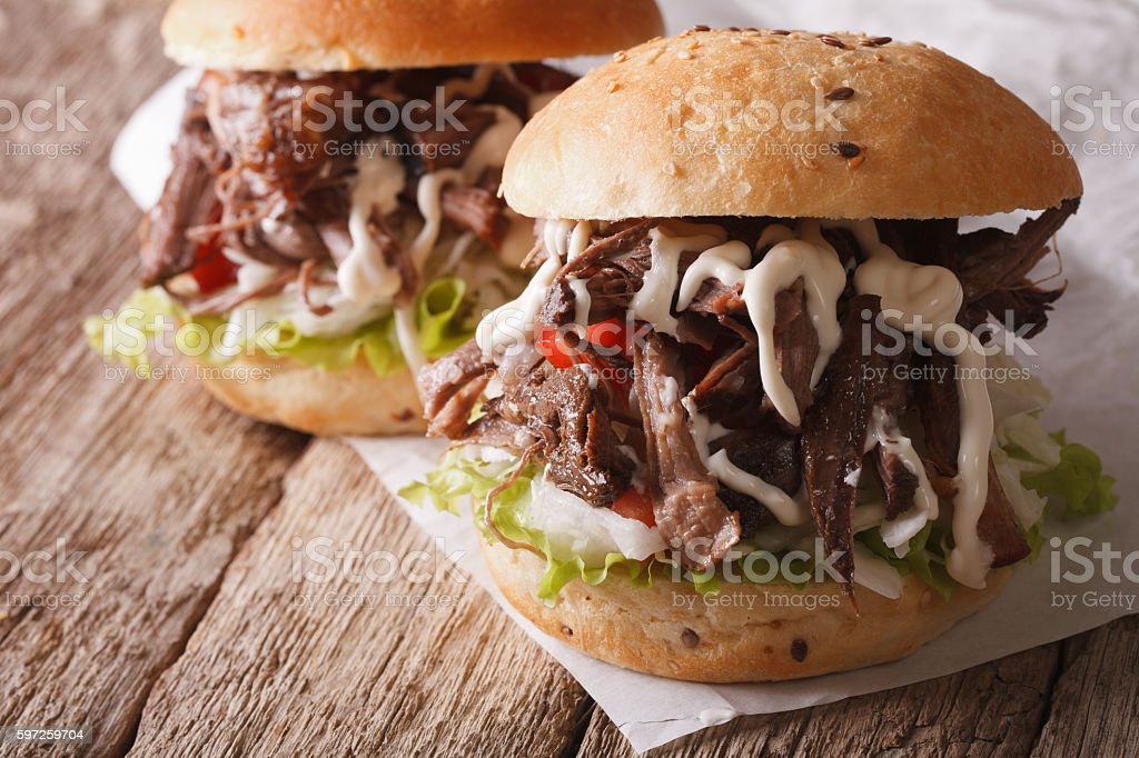 Pulled pork sandwich with coleslaw and mayonnaise close-up stock photo
