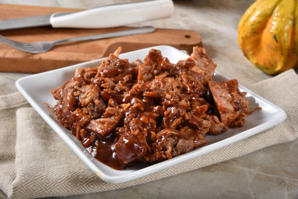 Pulled pork with BBQ sauce stock photo