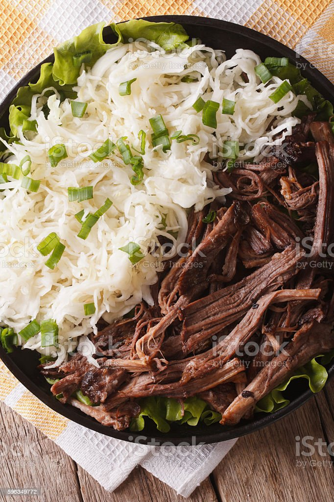 Pulled pork with cabbage salad close-up. vertical top view royalty-free stock photo
