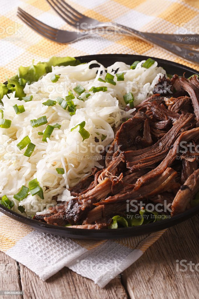 Pulled pork with coleslaw close-up on a plate. vertical Lizenzfreies stock-foto