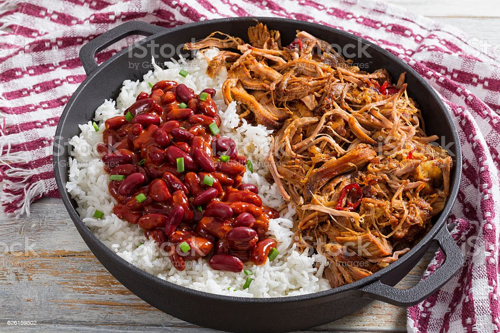 pulled  pork with long-grain basmati rice and red bean stock photo