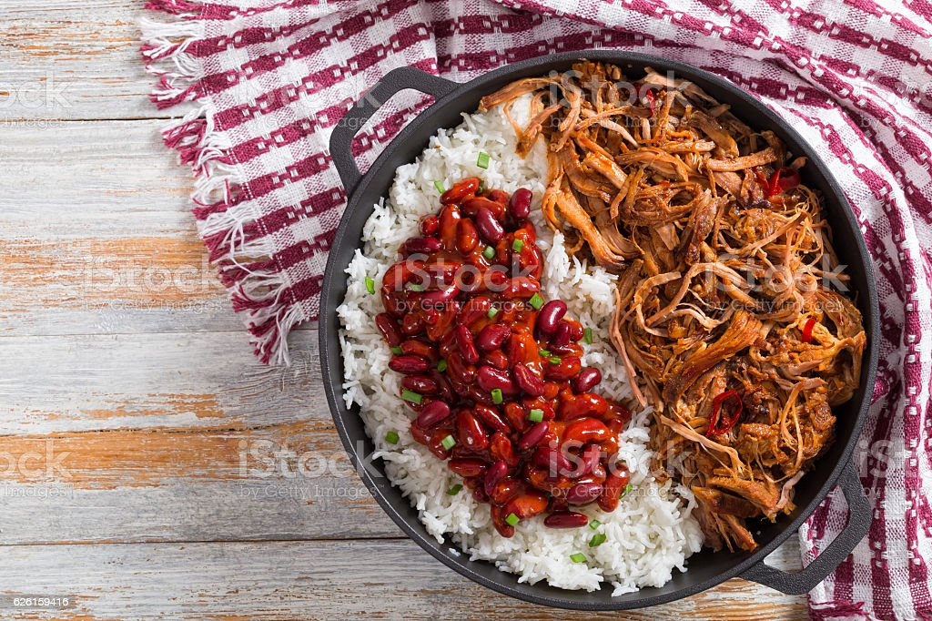 pulled slow-cooked  meat with rice and savory Baked Beans stock photo