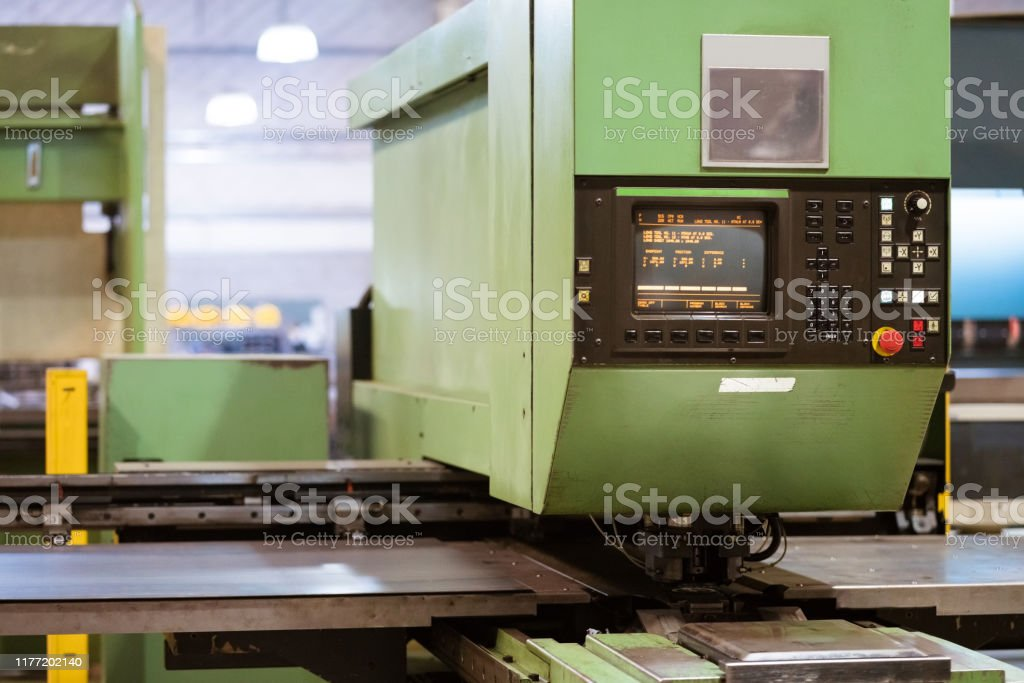 Puller machine in metal industry Green puller machine in industry. Control panel on manufacturing machinery. It is in factory. Absence Stock Photo