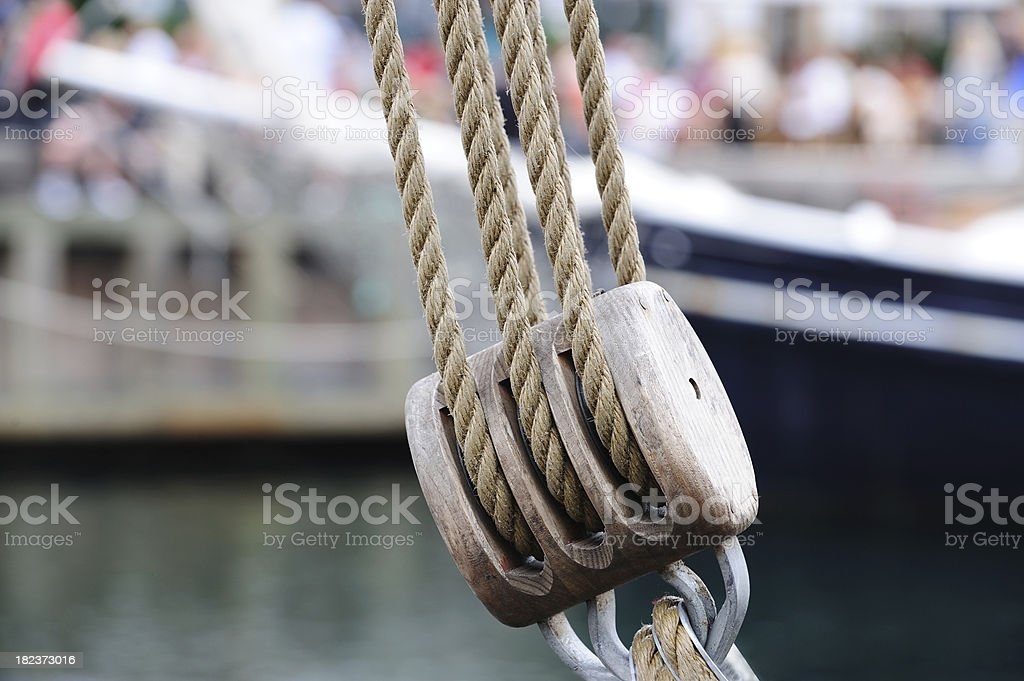 Pulley and ropes against blurred ships royalty-free stock photo