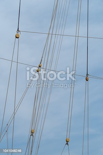 Sailing boat pulleys with nautical ropes