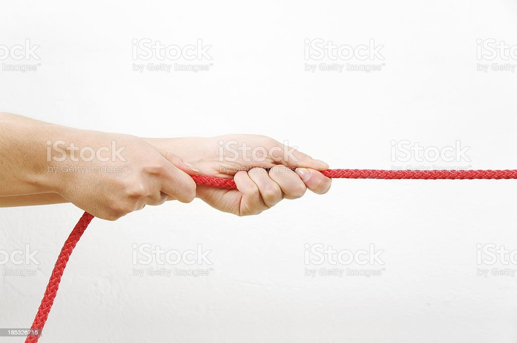 Pulling a rope stock photo