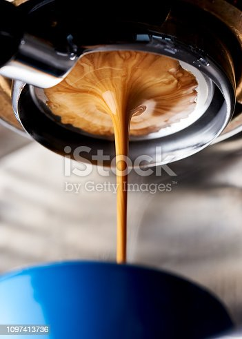 A perfect espresso shot extraction using a naked (bottomless) portafilter. This is a light roasted Ethiopia specialty coffee from a local roaster.f