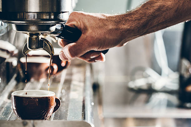 pulling a shot of espresso - barista stock photos and pictures