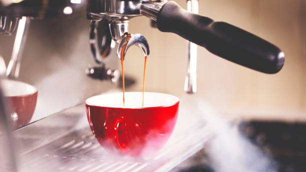 pulling a shot of espresso - coffee maker stock pictures, royalty-free photos & images