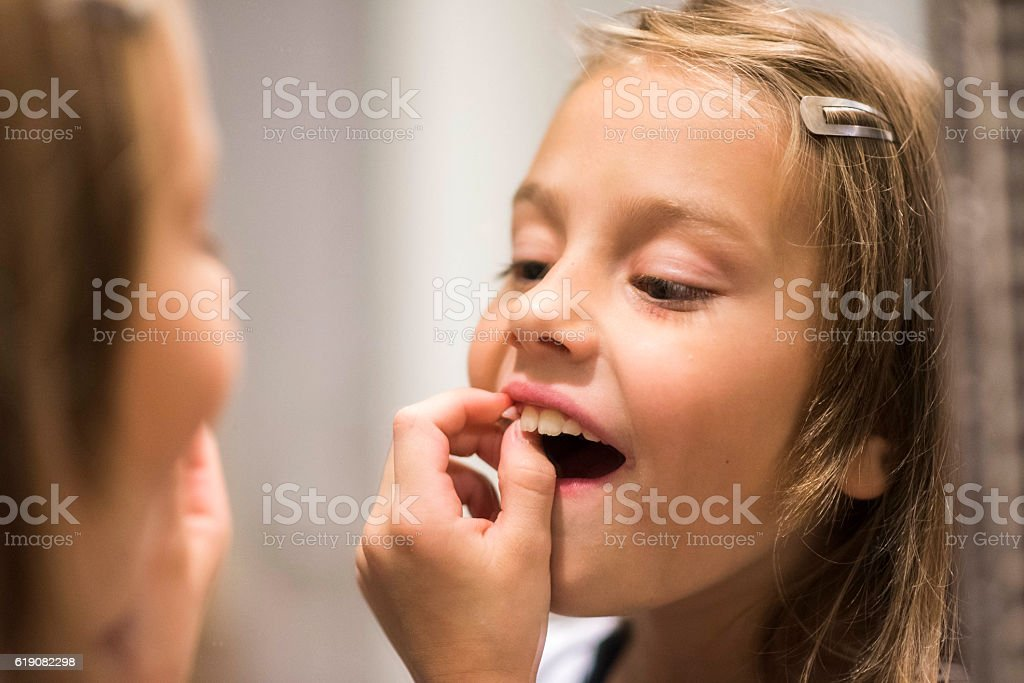 Pulling a tooth out stock photo