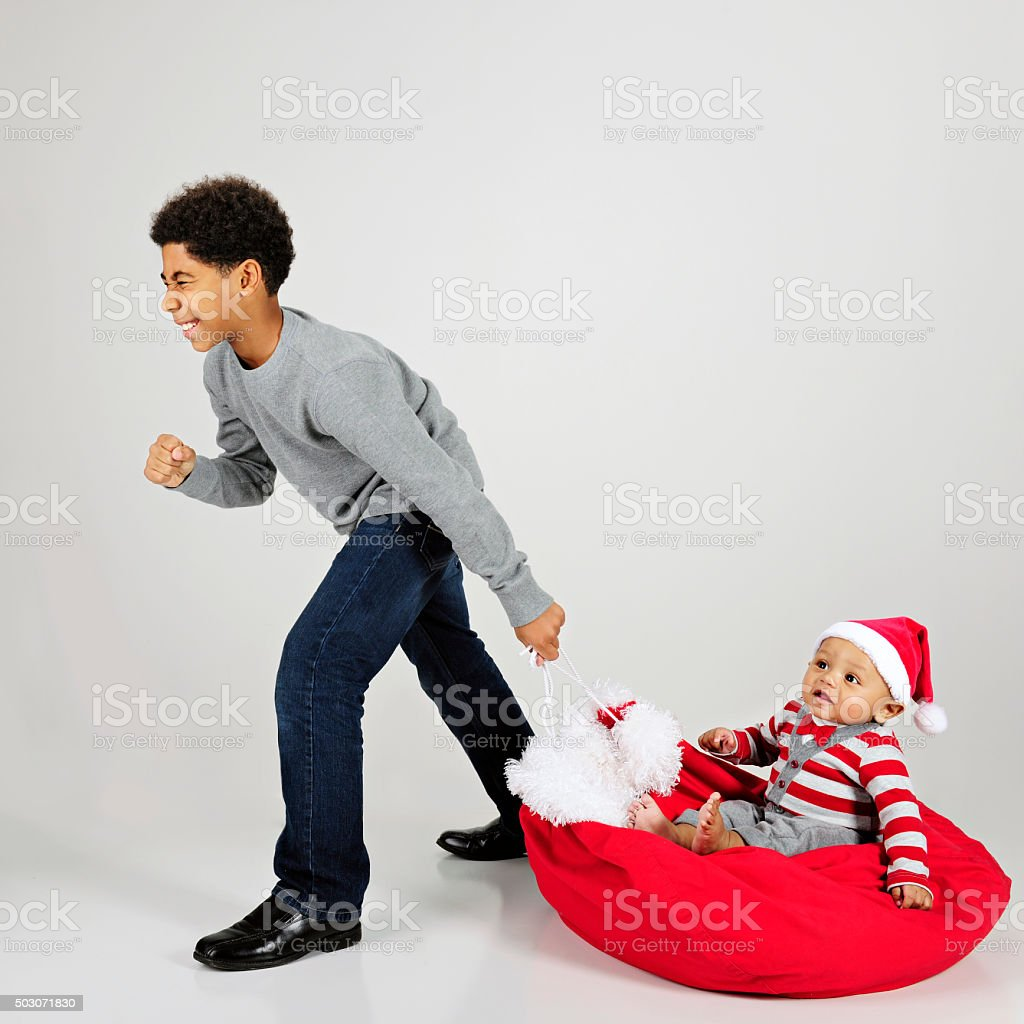 Pulling Baby for Christmas stock photo