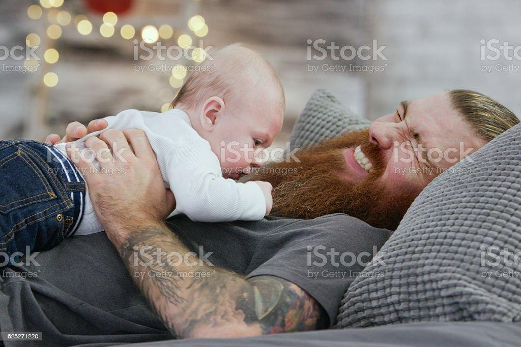 Pulling Dad's Beard stock photo
