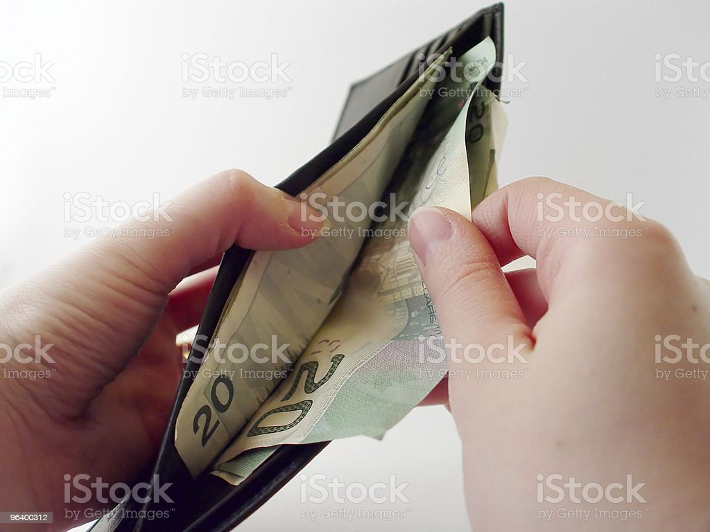 Pulling Money out of Wallet - Royalty-free 20-24 Years Stock Photo
