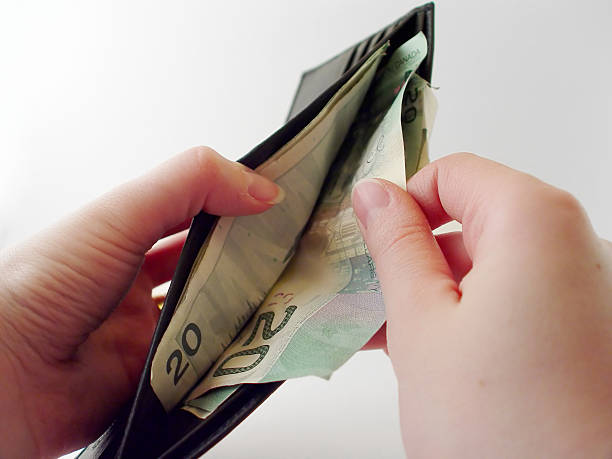 Pulling Money out of Wallet stock photo