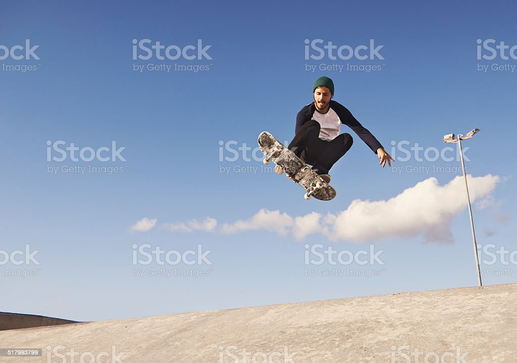 Pulling off a sick trick stock photo