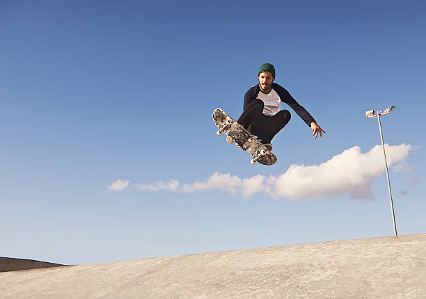 pulling off a sick trick - skateboard stock pictures, royalty-free photos & images