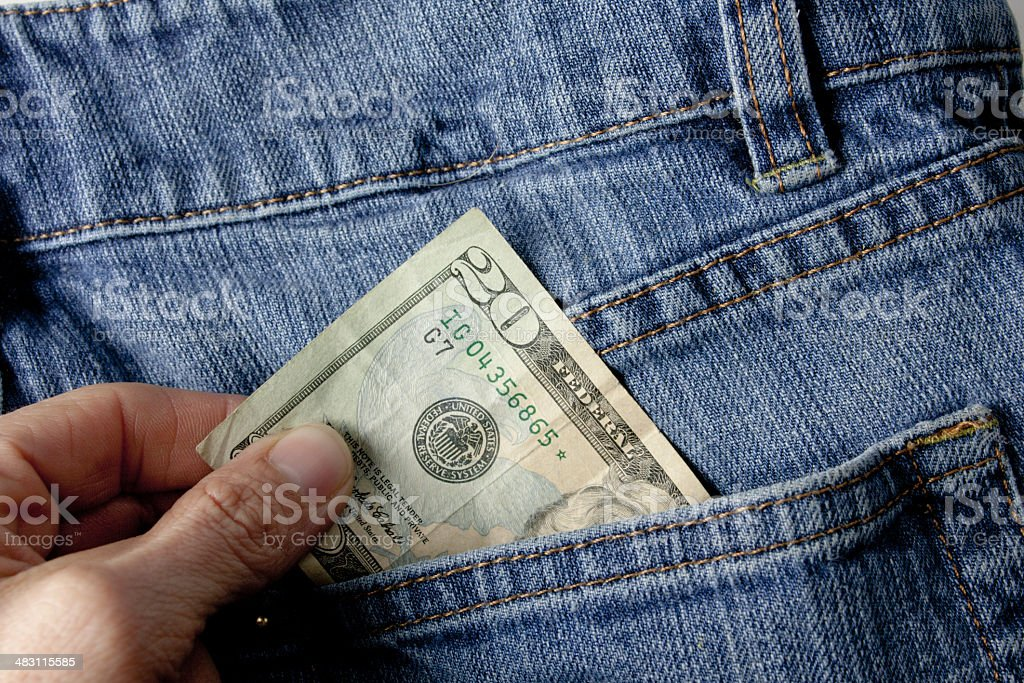 Pulling Out Money From Rear Pocket stock photo