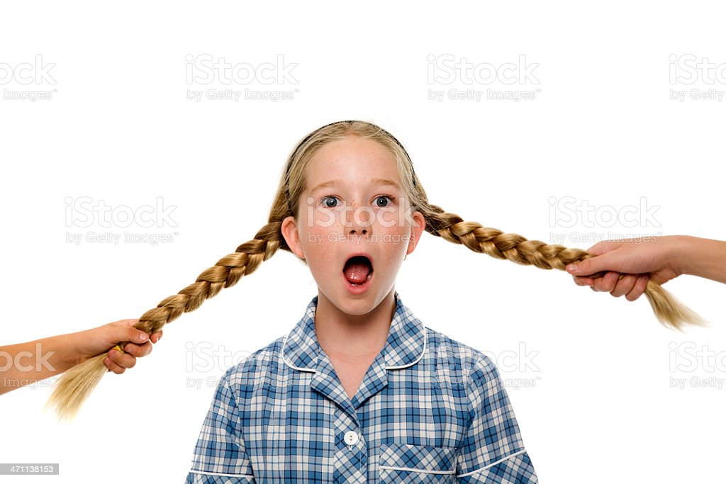 Pulling Pigtails royalty-free stock photo