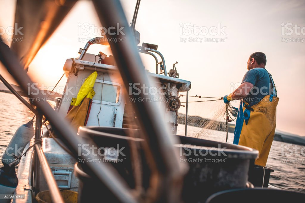 Pulling the net stock photo