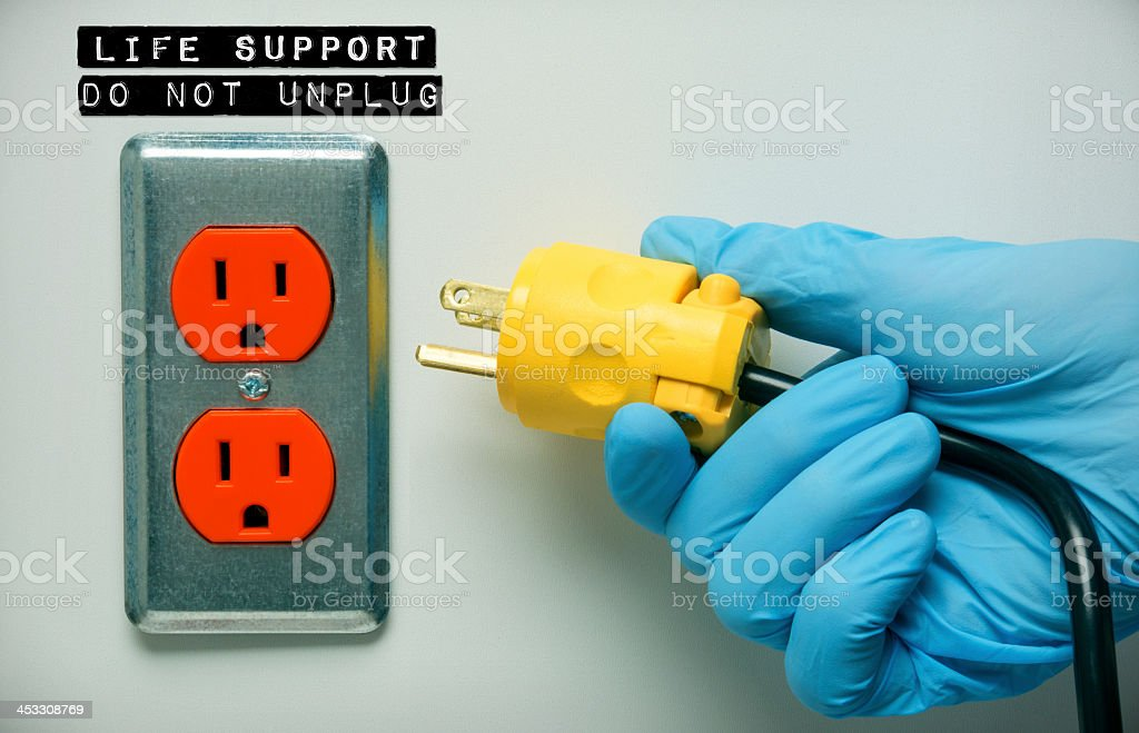 Pulling the plug on a patients life support stock photo