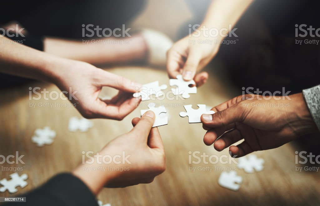Pulling together to solve a problem stock photo