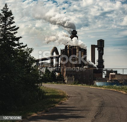 A road leads to a pulp and paper mill.