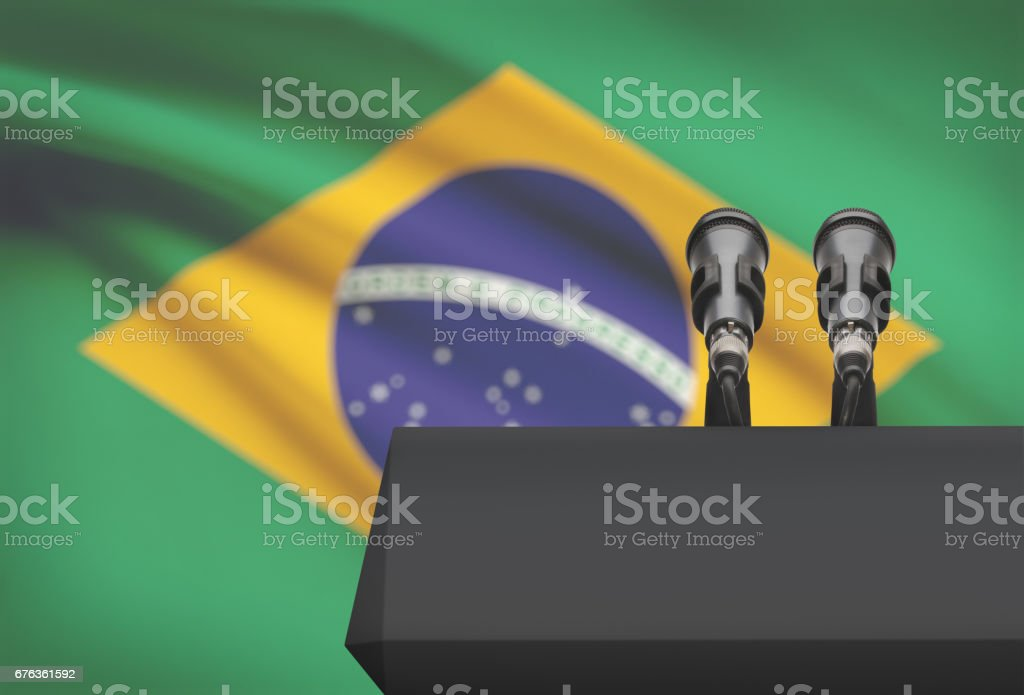 Pulpit and two microphones with a national flag on background - Brazil stock photo