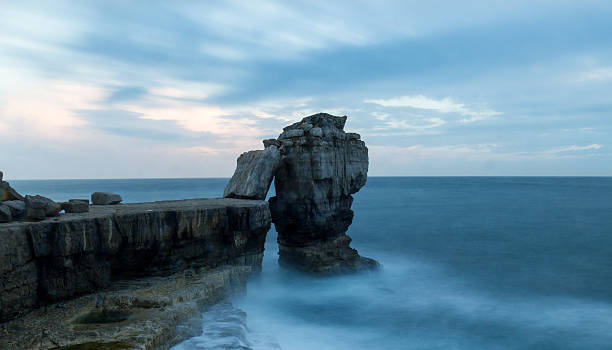 pulpit rock - portland in dorset - pulpit rock dorset stock photos and pictures